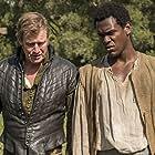 Jason Flemyng and Abubakar Salim in Jamestown (2017)