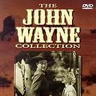 John Wayne and Cecilia Parker in Riders of Destiny (1933)