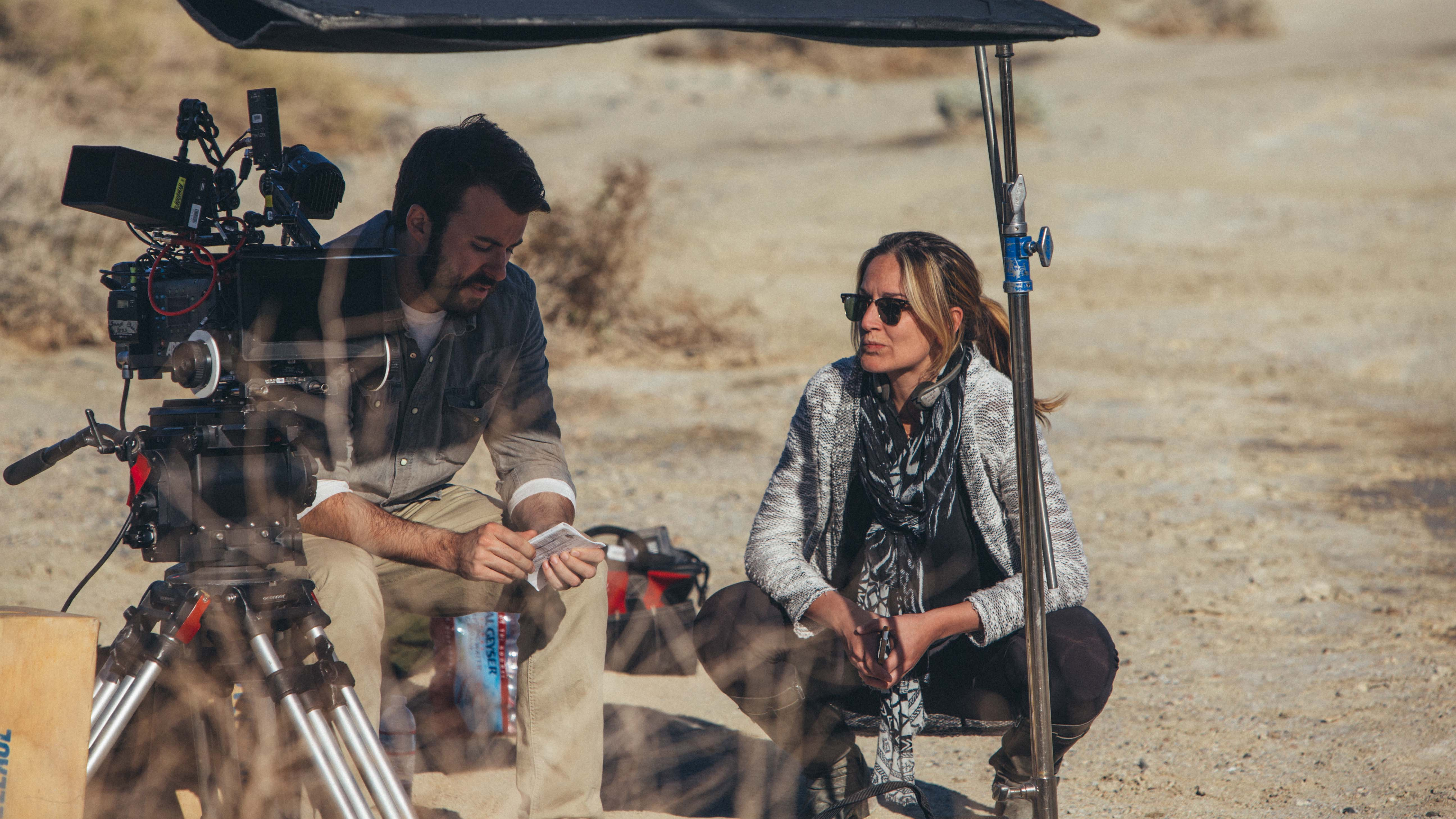 Director Ashley Avis working with cinematographer Garrett O'Brien on the set of Deserted
