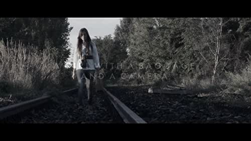 """The Trailer of the Short Film """"Images"""". A girl with a baggage and a camera, a railroad route, her life's journey."""