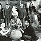 Groucho Marx, Virginia Grey, Patti Lacey, and Chico Marx in The Big Store (1941)