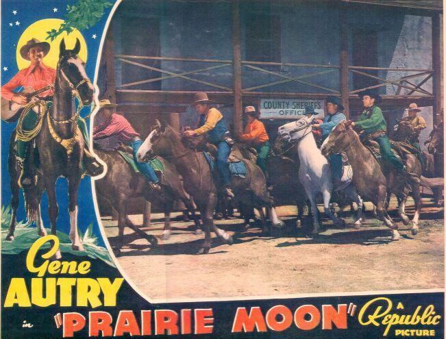 Gene Autry, Ray Bennett, Smiley Burnette, and Jack Rockwell in Prairie Moon (1938)