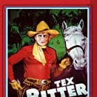 Tex Ritter and White Flash in Riders of the Frontier (1939)