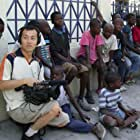 Young Man Kang and Clinton H. Wallace in Haitian Street Kids Revisited (2009)