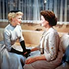 Gene Tierney and Ginger Rogers in Black Widow (1954)
