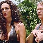 Julie Strain and Paul Logan in L.E.T.H.A.L. Ladies: Return to Savage Beach (1998)