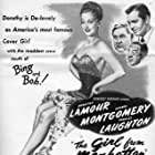 Charles Laughton, Hugh Herbert, Dorothy Lamour, and George Montgomery in The Girl from Manhattan (1948)
