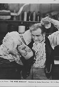 Philo McCullough and Tom Santschi in White Renegade (1931)