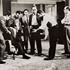 Humphrey Bogart, Rod Steiger, Val Avery, Herbie Faye, Carlos Montalbán, and Nehemiah Persoff in The Harder They Fall (1956)