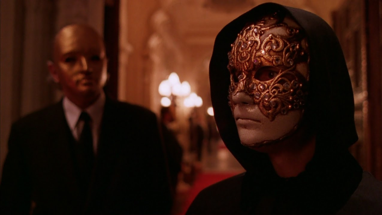 Tom Cruise and Brian W. Cook in Eyes Wide Shut (1999)
