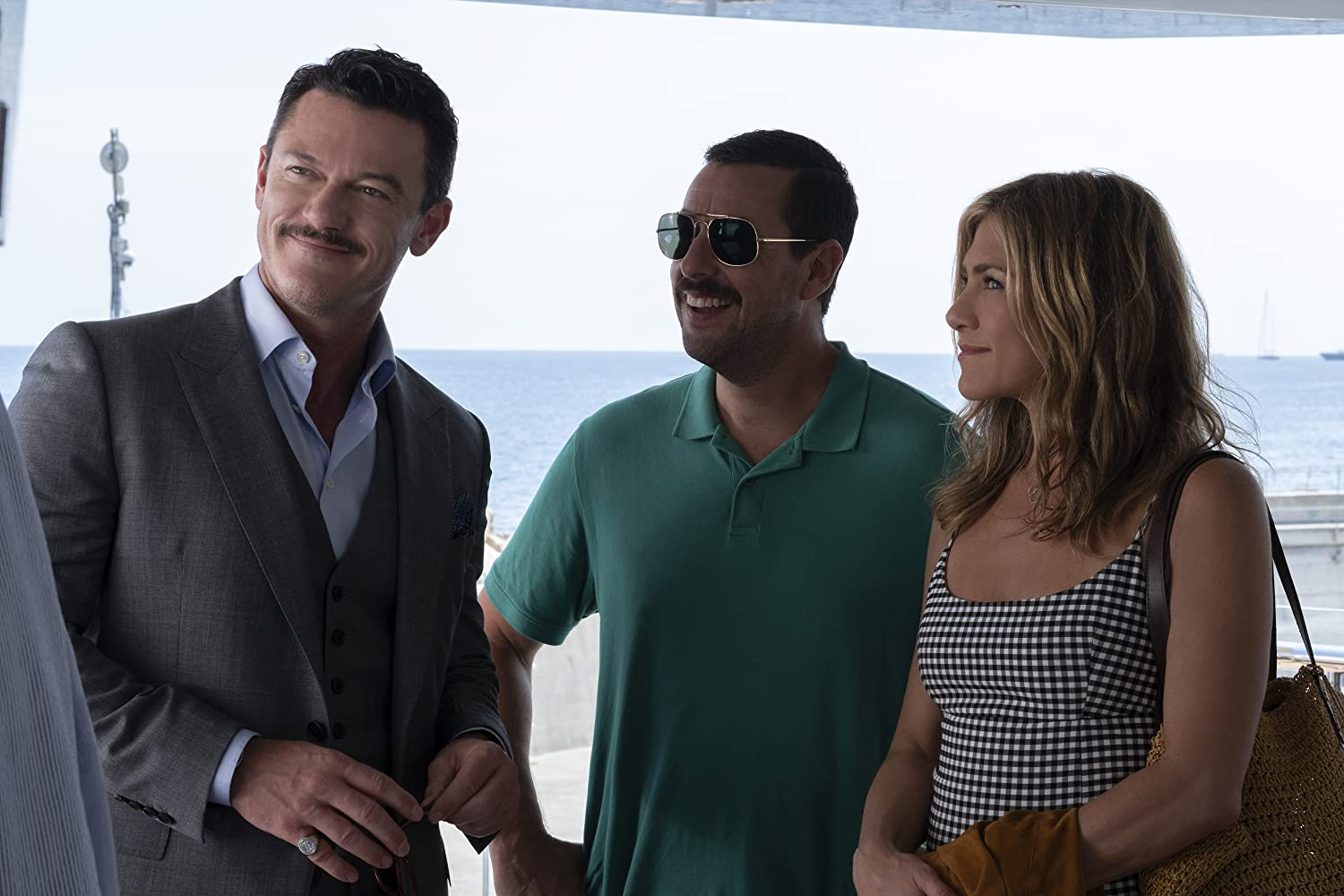 Jennifer Aniston, Adam Sandler, and Luke Evans in Murder Mystery (2019)