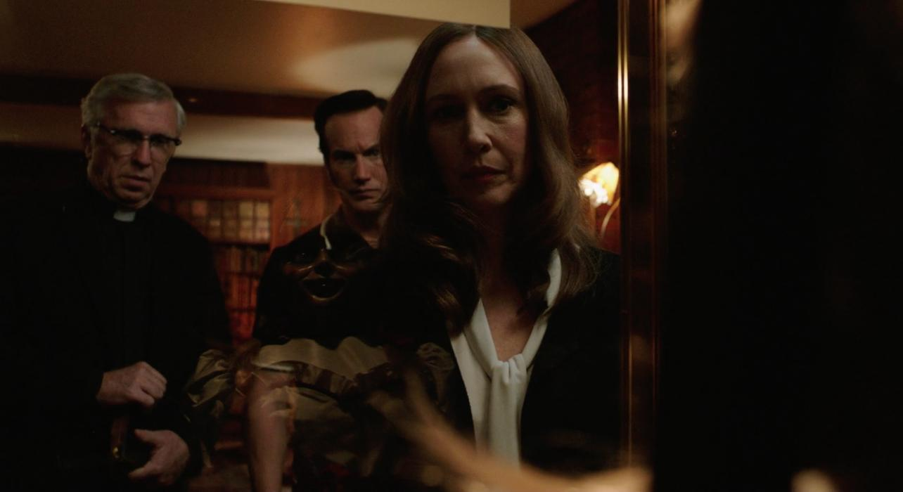 Steve Coulter, Vera Farmiga, and Patrick Wilson in Annabelle Comes Home (2019)