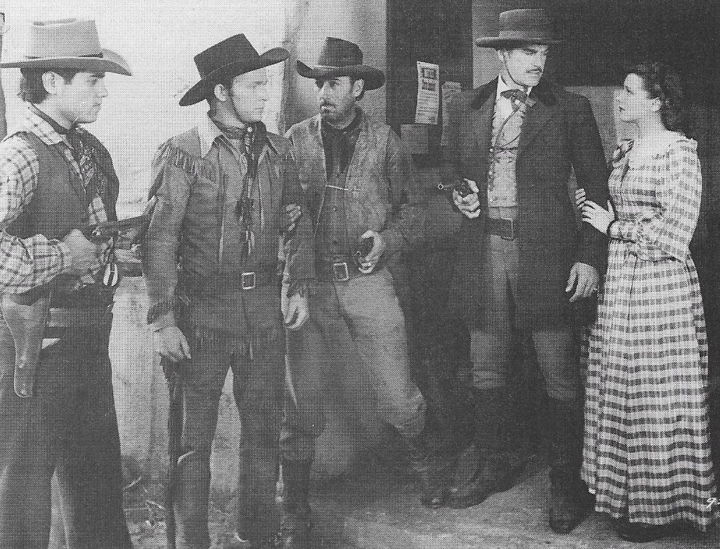 Roy Rogers, Chuck Baldra, Julie Bishop, Henry Wills, and Harry Woods in The Ranger and the Lady (1940)
