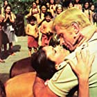 Pamela Hensley and Ron Ely in Doc Savage: The Man of Bronze (1975)