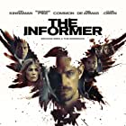 Clive Owen, Rosamund Pike, Common, Joel Kinnaman, and Ana de Armas in The Informer (2019)
