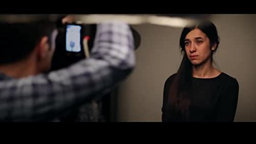 After surviving the 2014 genocide of the Yazidis in Northern Iraq and escaping sexual slavery at the hands of ISIS, 23-year-old Nadia Murad gave a testimony before the UN Security Council that was heard around the world. On Her Shoulders follows Nadia during the peak of her advocacy campaign.