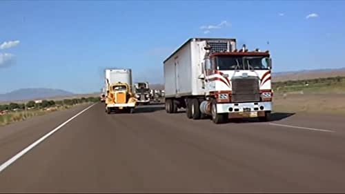 """Truckers form a mile long """"convoy"""" in support of a trucker's vendetta with an abusive sheriff...Based on the country song of same title by C.W. McCall."""