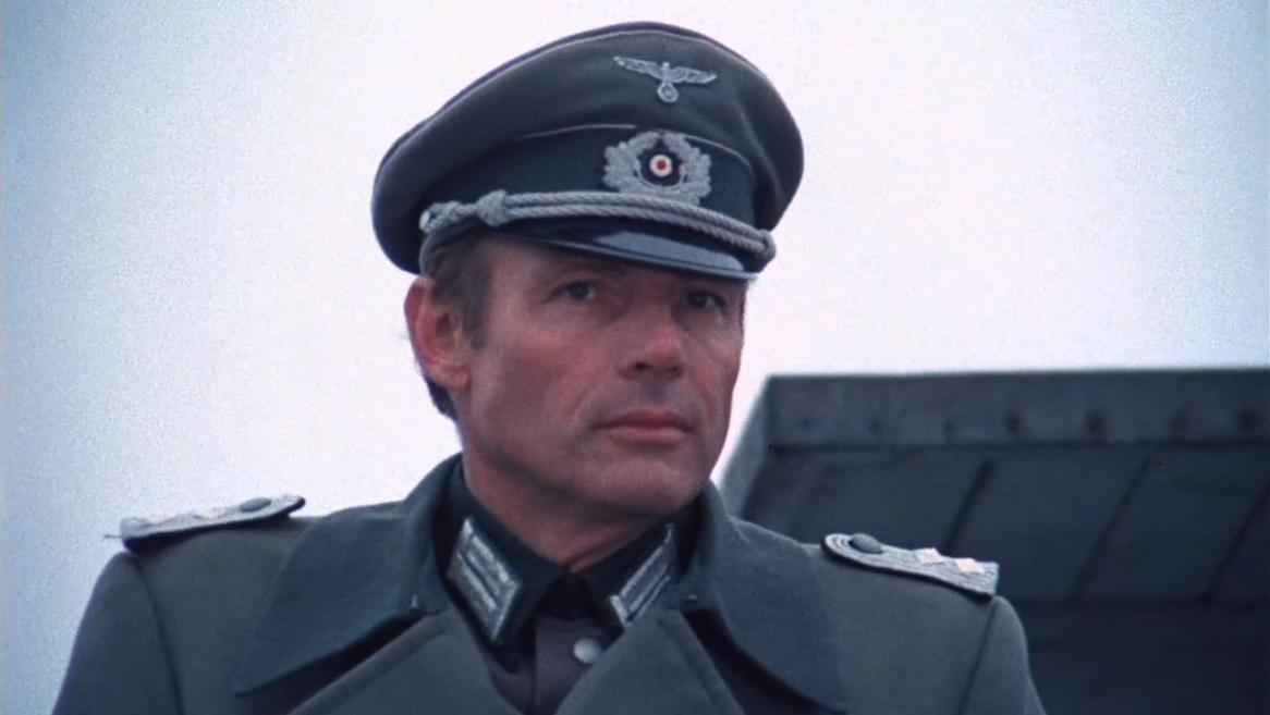 Adam West in Partizani (1974)
