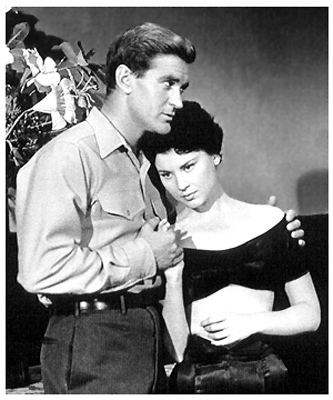 Rod Taylor and Lisa Montell in World Without End (1956)