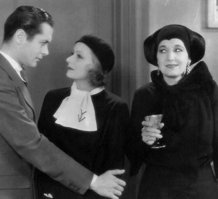 Greta Garbo, Robert Montgomery, and Judith Vosselli in Inspiration (1931)