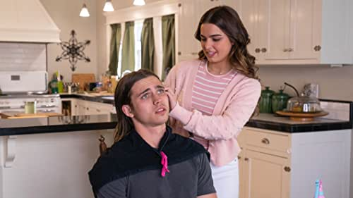 An influencer (Addison Rae) accepts a challenge to turn the school's biggest loser (Tanner Buchanan) into prom king.