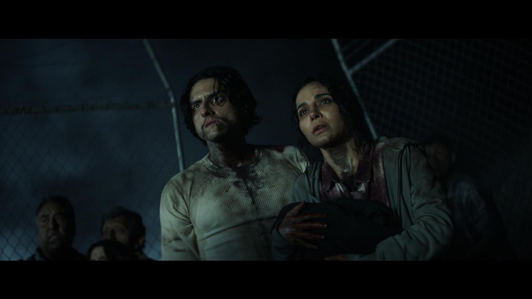 Martha Higareda and Richard Cabral in Into the Dark (2018)
