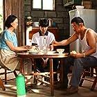 Mei Yong, Jingchun Wang, and Roy Wang in Di jiu tianchang (2019)
