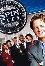 Michael J. Fox, Barry Bostwick, Alan Ruck, Michael Boatman, Connie Britton, Alexander Chaplin, and Richard Kind in Spin City (1996)