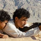 Jacir Eid Al-Hwietat and Hussein Salameh Al-Sweilhiyeen in Theeb (2014)