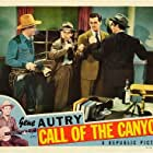 Gene Autry, John Harmon, Marc Lawrence, and Edmund MacDonald in Call of the Canyon (1942)