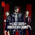 Michael Pitt, Anna Brewster, and Edgar Ramírez in The Last Days of American Crime (2020)