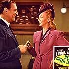 William Gargan and Carole Landis in Behind Green Lights (1946)