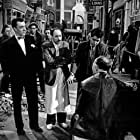 Harry Brunning, George A. Cooper, George Eugeniou, John Gregson, Gordon Humphris, and Cyril Shaps in Miracle in Soho (1957)