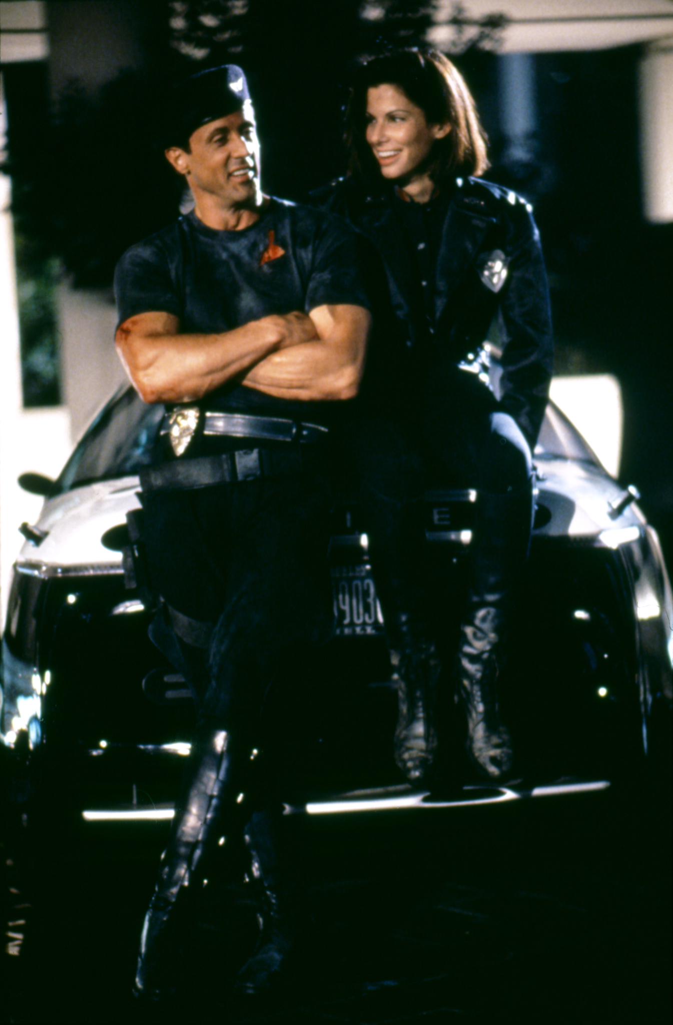 Sandra Bullock and Sylvester Stallone in Demolition Man (1993)