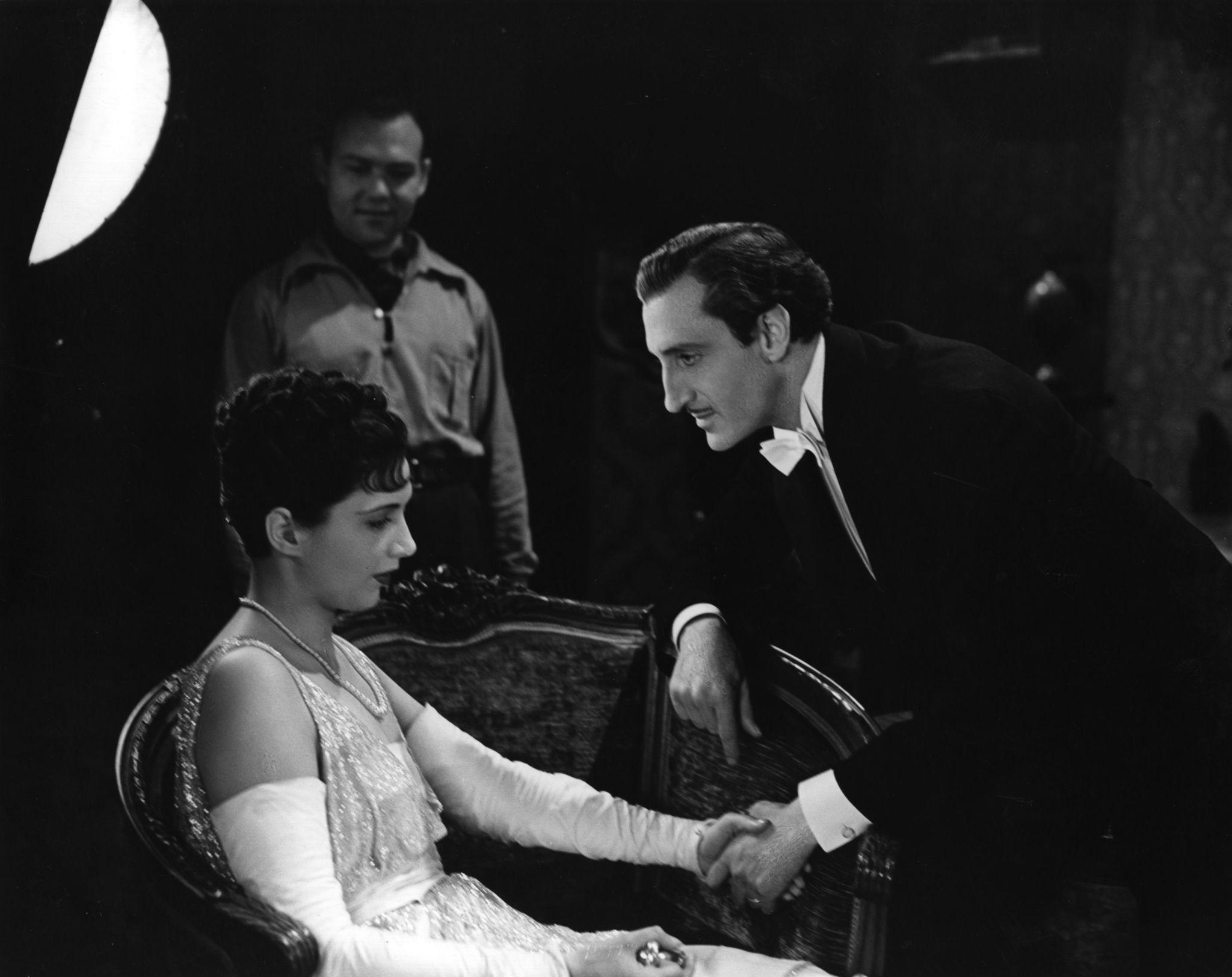 Basil Rathbone, Kay Francis, and Joe May in Confession (1937)