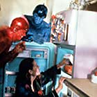 Jim Carrey, Geena Davis, Jeff Goldblum, and Damon Wayans in Earth Girls Are Easy (1988)