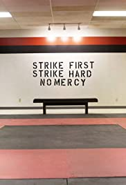 Strike First Poster