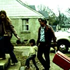 Benicio Del Toro, Melissa Leo, Marc Musso, and Teresa Delgado in 21 Grams (2003)