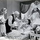 Olivia de Havilland, Bonita Granville, Isabel Jeans, and Charles Winninger in Hard to Get (1938)
