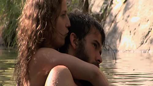A couple's honeymoon is cut short when they encounter some feral strangers in the wilderness.
