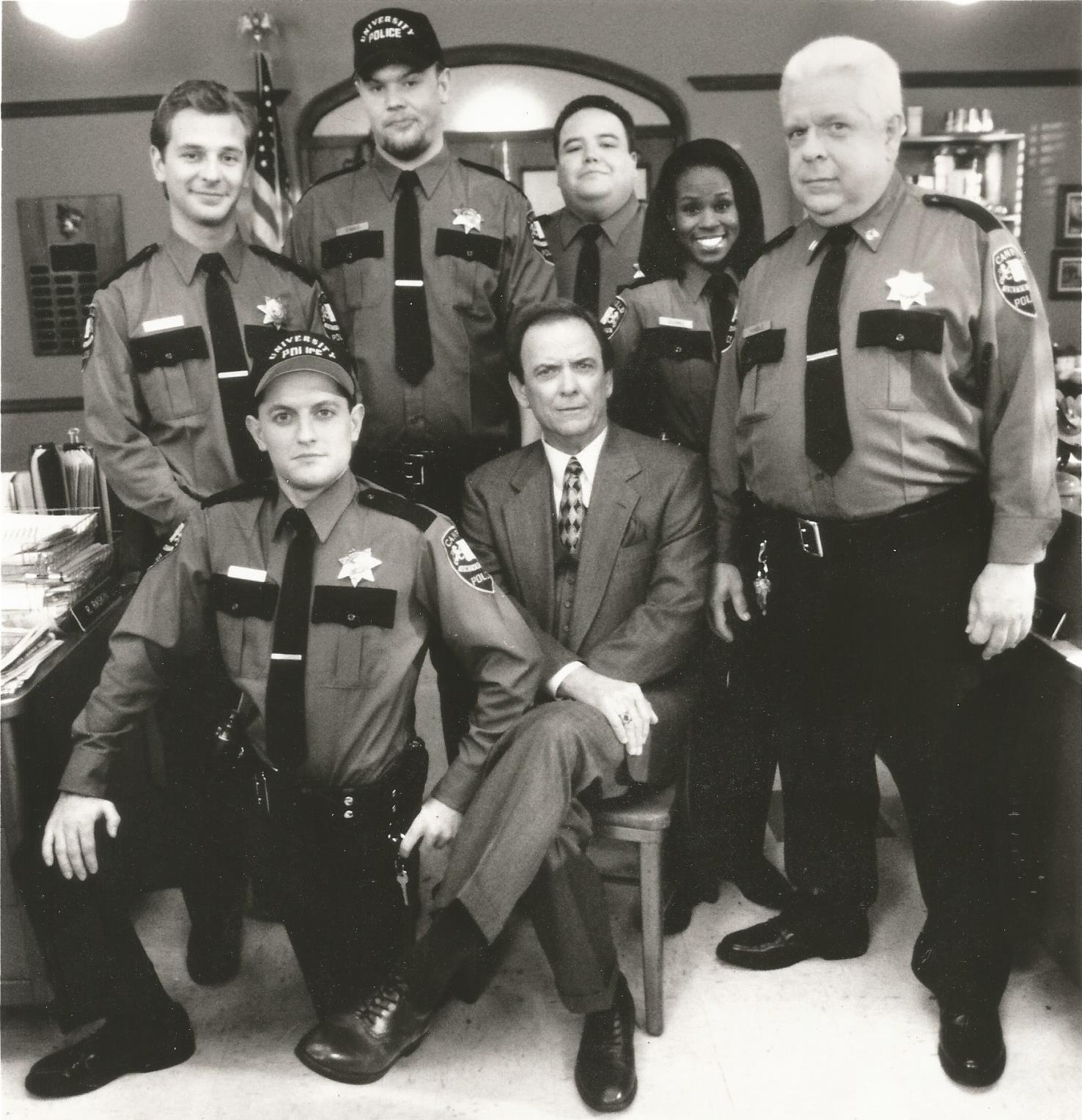 Ben Bode, JD Cullum, Ryan Hurst, Jerry Kernion, Monte Markham, David Sage, and LaRita Shelby in Campus Cops (1995)