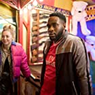 Hermione Corfield and Dipo Ola in We Hunt Together (2020)