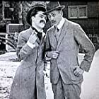 Charles Chaplin and Henry Lehrman in Making a Living (1914)