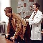 Jørgen Kiil and Ulf Pilgaard in Pas på ryggen, professor! (1977)