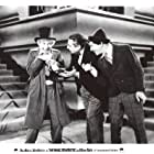 Chico Marx, Harpo Marx, and Louis Sorin in Animal Crackers (1930)