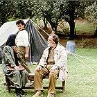 Mohamad Ali Keshavarz, Hossein Rezai, and Zarifeh Shiva in Zire darakhatan zeyton (1994)