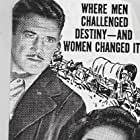 Max Baer, Richard Dix, and Jane Wyatt in Buckskin Frontier (1943)