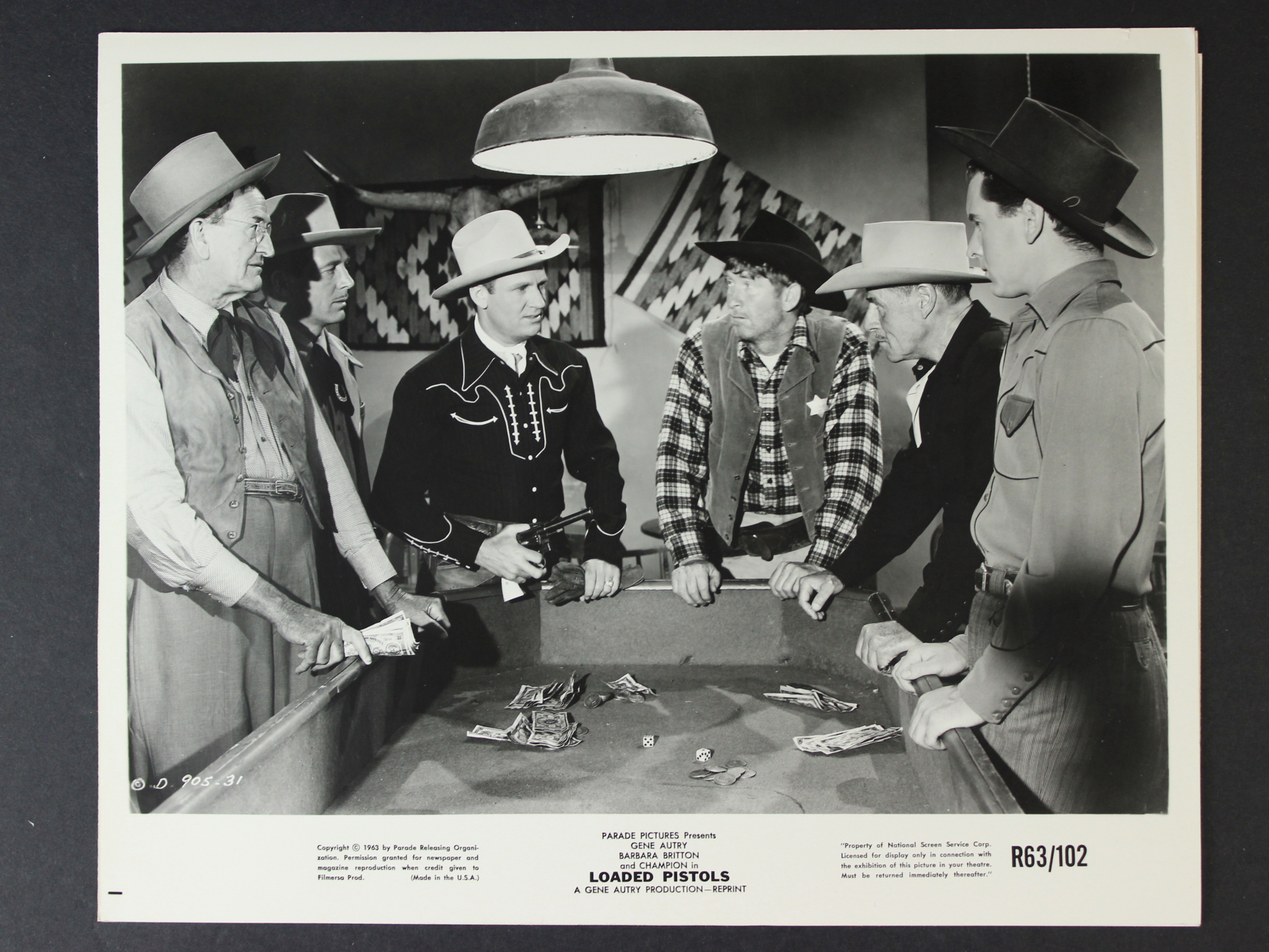 Gene Autry, Russell Arms, Jack Holt, Robert Shayne, Leon Weaver, and Chill Wills in Loaded Pistols (1948)