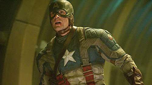 After being deemed unfit for military service, Steve Rogers volunteers for a top secret research project that turns him into Captain America, a superhero dedicated to defending America's ideals.