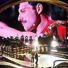 Roger Taylor, Brian May, Freddie Mercury, Queen, and Adam Lambert in The Show Must Go On: The Queen + Adam Lambert Story (2019)